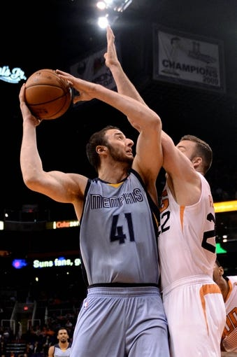 Jan 2, 2014; Phoenix, AZ, USA; Memphis Grizzlies center Kosta Koufos (41) in action against the Phoenix Suns forward Miles Plumlee (22) in the first half at US Airways Center.  The Grizzlies won 99-91. Mandatory Credit: Jennifer Stewart-USA TODAY Sports
