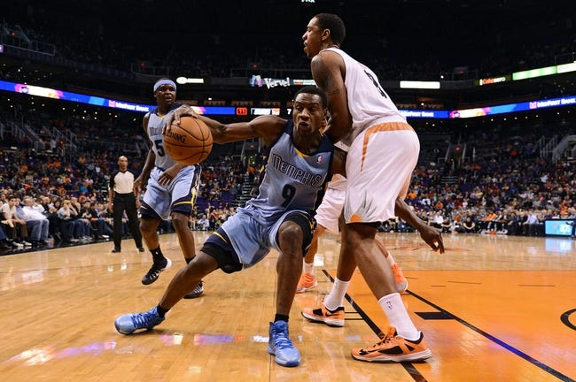 Jan 2, 2014; Phoenix, AZ, USA; Memphis Grizzlies guard Tony Allen (9) handles the ball against defender Phoenix Suns forward Channing Frye (8) in the first half at US Airways Center.  The Grizzlies won 99-91. Mandatory Credit: Jennifer Stewart-USA TODAY Sports
