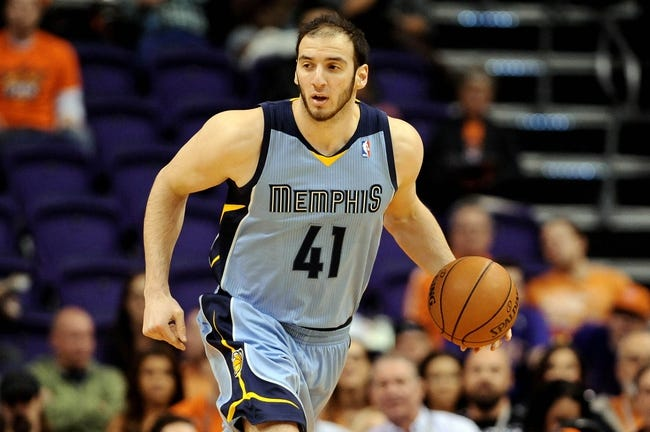 Jan 2, 2014; Phoenix, AZ, USA; Memphis Grizzlies center Kosta Koufos (41) dribbles the ball up the court against the Phoenix Suns in the first half at US Airways Center.  The Grizzlies won 99-91. Mandatory Credit: Jennifer Stewart-USA TODAY Sports