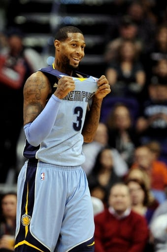 Jan 2, 2014; Phoenix, AZ, USA; Memphis Grizzlies forward James Johnson (3) reacts on the court against the Phoenix Suns in the second half at US Airways Center.  The Grizzlies won 99-91. Mandatory Credit: Jennifer Stewart-USA TODAY Sports