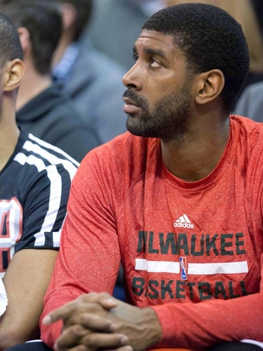 Jan 2, 2014; Salt Lake City, UT, USA; Milwaukee Bucks shooting guard O.J. Mayo (00) watches from the bench during the second half against the Utah Jazz at EnergySolutions Arena. The Jazz won 96-87. Mandatory Credit: Russ Isabella-USA TODAY Sports