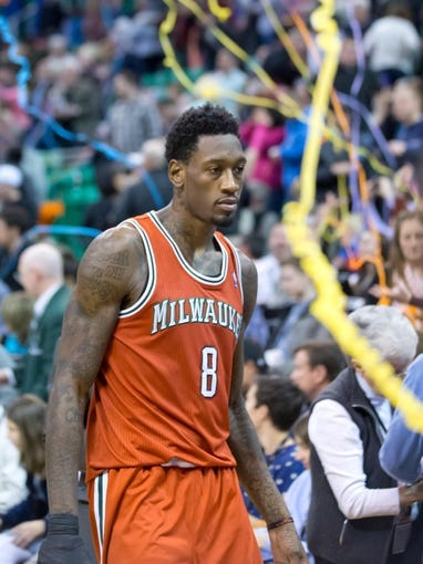 Jan 2, 2014; Salt Lake City, UT, USA; Milwaukee Bucks center Larry Sanders (8) leaves the court after losing to the Utah Jazz 96-87 at EnergySolutions Arena. Mandatory Credit: Russ Isabella-USA TODAY Sports