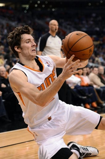 Jan 2, 2014; Phoenix, AZ, USA; Phoenix Suns guard Goran Dragic (1) makes a pass while slipping on the floor against the Memphis Grizzlies in the second half at US Airways Center. The Grizzlies won 99-91. Mandatory Credit: Jennifer Stewart-USA TODAY Sports