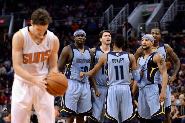 Jan 2, 2014; Phoenix, AZ, USA; Memphis Grizzlies guard Mike Conley (11) talks with teammates forward Zach Randolph (50), forward Mike Miller (13), guard Jerryd Bayless (7) and forward Ed Davis (32) as Phoenix Suns guard Goran Dragic (1) shoots a technical foul shot in the second half at US Airways Center.  The Grizzlies won 99-91. Mandatory Credit: Jennifer Stewart-USA TODAY Sports