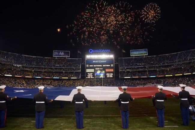 Dec 30, 2013; San Diego, CA, USA; General view of fireworks during the playing of the national anthem with a United States flag on the field in the 2013 Holiday Bowl between the Arizona State Sun Devils and the Texas Tech Red Raiders at Qualcomm Stadium. Mandatory Credit: Kirby Lee-USA TODAY Sports