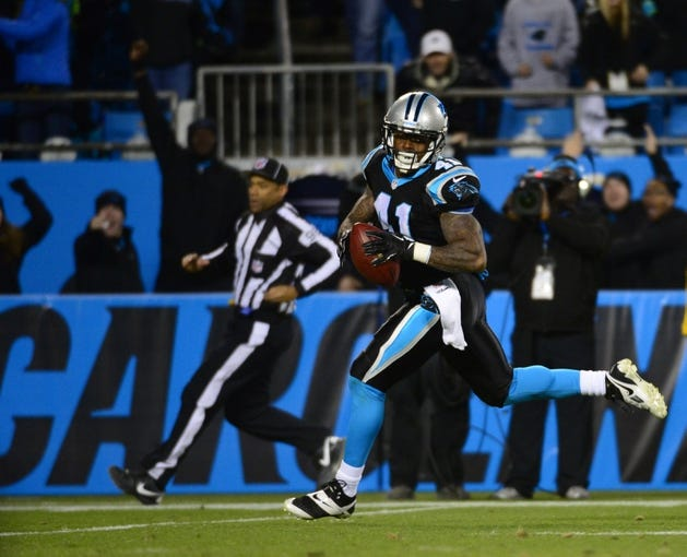 Dec 15, 2013; Charlotte, NC, USA; Carolina Panthers cornerback Captain Munnerlyn (41) returns an interception for a touchdown in the fourth quarter at Bank of America Stadium. Mandatory Credit: Bob Donnan-USA TODAY Sports