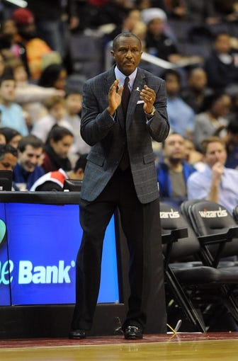 Jan 3, 2014; Washington, DC, USA; Toronto Raptors head coach Dwane Casey reacts against the Washington Wizards during the second half at Verizon Center. The Raptors defeated the Wizards 101 - 88. Mandatory Credit: Brad Mills-USA TODAY Sports