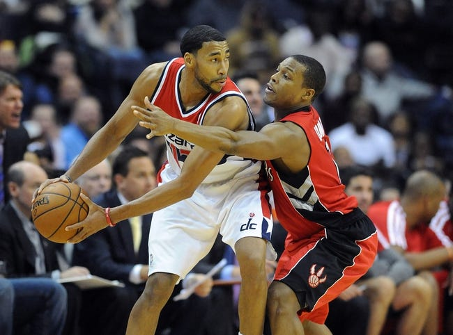 Jan 3, 2014; Washington, DC, USA; Washington Wizards shooting guard Garrett Temple (17) looks to pass as Toronto Raptors point guard Kyle Lowry (7) defends during the second half at Verizon Center. The Raptors defeated the Wizards 101 - 88. Mandatory Credit: Brad Mills-USA TODAY Sports