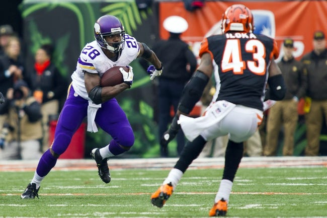Dec 22, 2013; Cincinnati, OH, USA;  Minnesota Vikings running back Adrian Peterson (28) runs the ball at Cincinnati Bengals strong safety George Iloka (43) in the second half of the game at Paul Brown Stadium. Cincinnati Bengals beat the Minnesota Vikings by the score of 42-14. Mandatory Credit: Trevor Ruszkowksi-USA TODAY Sports