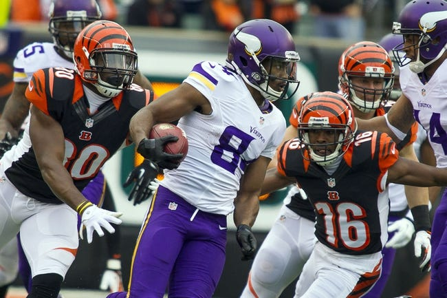 Dec 22, 2013; Cincinnati, OH, USA;  Minnesota Vikings wide receiver Cordarrelle Patterson (84) runs the ball with Cincinnati Bengals tight end Orson Charles (80) and wide receiver Andrew Hawkins (16) in pursuit to tackle him in the second half at Paul Brown Stadium. Cincinnati Bengals beat the Minnesota Vikings by the score of 42-14. Mandatory Credit: Trevor Ruszkowksi-USA TODAY Sports