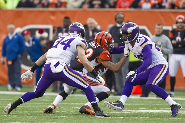 Dec 22, 2013; Cincinnati, OH, USA;  Cincinnati Bengals wide receiver Mohamed Sanu (12) is cornered by Minnesota Vikings cornerback Chris Cook (20) and free safety Andrew Sendejo (34) in the game at Paul Brown Stadium. Cincinnati Bengals beat the Minnesota Vikings by the score of 42-14. Mandatory Credit: Trevor Ruszkowksi-USA TODAY Sports