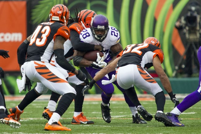 Dec 22, 2013; Cincinnati, OH, USA; Minnesota Vikings running back Adrian Peterson (28) is tackled by Cincinnati Bengals defensive back Chris Crocker (32) and strong safety George Iloka (43) and defensive tackle Christo Bilukidi (90) in the second half of the game at Paul Brown Stadium. Cincinnati Bengals beat the Minnesota Vikings by the score of 42-14. Mandatory Credit: Trevor Ruszkowksi-USA TODAY Sports