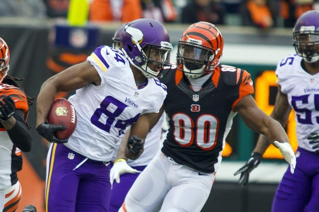 Dec 22, 2013; Cincinnati, OH, USA;   Minnesota Vikings wide receiver Cordarrelle Patterson (84) runs the ball with Cincinnati Bengals tight end Orson Charles (80) in pursuit to tackle him in the second half at Paul Brown Stadium. Cincinnati Bengals beat the Minnesota Vikings by the score of 42-14. Mandatory Credit: Trevor Ruszkowksi-USA TODAY Sports