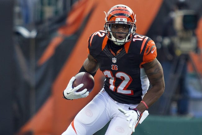 Dec 22, 2013; Cincinnati, OH, USA;  Cincinnati Bengals wide receiver Mohamed Sanu (12) runs the ball in the game against the Minnesota Vikings at Paul Brown Stadium. Cincinnati Bengals beat the Minnesota Vikings by the score of 42-14. Mandatory Credit: Trevor Ruszkowksi-USA TODAY Sports