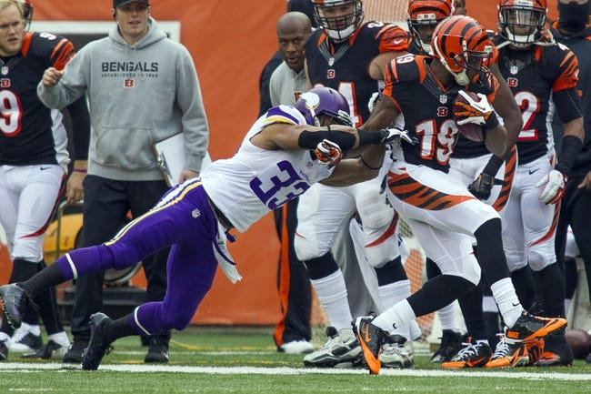 Dec 22, 2013; Cincinnati, OH, USA;  Cincinnati Bengals wide receiver Brandon Tate (19) avoids the tackle of Minnesota Vikings strong safety Jamarca Sanford (33) in the second half of the game at Paul Brown Stadium. Cincinnati Bengals beat the Minnesota Vikings by the score of 42-14. Mandatory Credit: Trevor Ruszkowksi-USA TODAY Sports