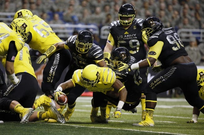 Jan 4, 2014; San Antonio, TX, USA; West running back Royce Freeman (23) dives for a touchdown during U.S. Army All-American Bowl high school football game at the Alamodome. Mandatory Credit: Soobum Im-USA TODAY Sports