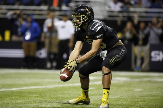 Jan 4, 2014; San Antonio, TX, USA; East quarterback Jacob Park (10) recovers his own fumble during U.S. Army All-American Bowl high school football game at the Alamodome. Mandatory Credit: Soobum Im-USA TODAY Sports