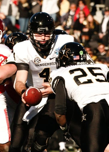 Jan 4, 2014; Birmingham, AL, USA;  Vanderbilt Commodores quarterback Patton Robinette (4) hands the ball off to   running back Brian Kimbrow (25) during the 2014 Compass Bowl at Legion Field. The Commodores defeated the Cougars 41-24. Mandatory Credit: Marvin Gentry-USA TODAY Sports