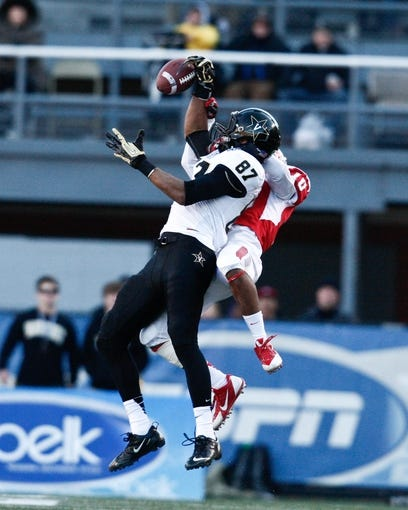 Jan 4, 2014; Birmingham, AL, USA;  Vanderbilt Commodores wide receiver Jordan Matthews (87) goes for the ball as Houston Cougars defensive back Zachary McMillian (10) knocks it down during the 2014 Compass Bowl at Legion Field. The Commodores defeated the Cougars 41-24. Mandatory Credit: Marvin Gentry-USA TODAY Sports