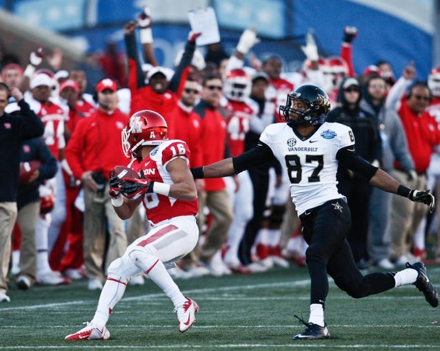 Jan 4, 2014; Birmingham, AL, USA; Houston Cougars defensive back Adrian McDonald (16) intercepts a pass from  Vanderbilt Commodores quarterback Patton Robinette (4) (not shown) during the 2014 Compass Bowl at Legion Field. The Commodores defeated the Cougars 41-24. Mandatory Credit: Marvin Gentry-USA TODAY Sports