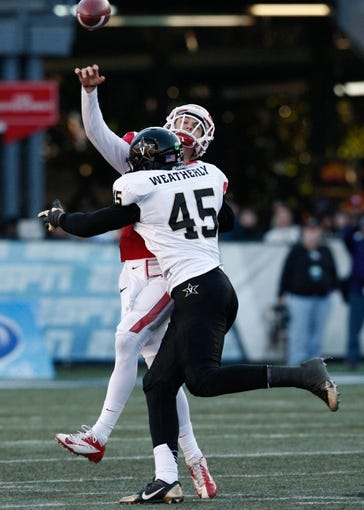 Jan 4, 2014; Birmingham, AL, USA; Houston Cougars quarterback John O'Korn (5) is hit by  Vanderbilt Commodores defensive end Stephen Weatherly (45)  during the 2014 Compass Bowl at Legion Field. The Commodores defeated the Cougars 41-24. Mandatory Credit: Marvin Gentry-USA TODAY Sports