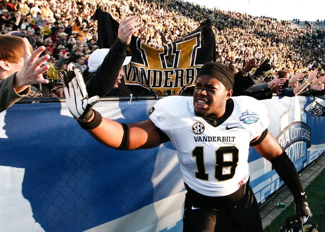 Jan 4, 2014; Birmingham, AL, USA;  Vanderbilt Commodores linebacker Patrick Sutton (18) celebrates after his team won the 2014 Compass Bowl at Legion Field. The Commodores defeated the Cougars 41-24. Mandatory Credit: Marvin Gentry-USA TODAY Sports