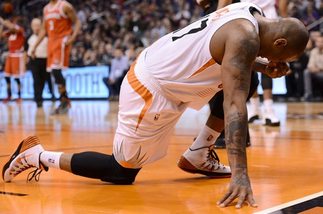 Jan 4, 2014; Phoenix, AZ, USA; Phoenix Suns forward P.J. Tucker (17) reacts after being hit in the face in the first half against the Milwaukee Bucks at US Airways Center. Mandatory Credit: Jennifer Stewart-USA TODAY Sports
