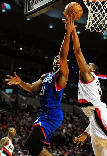 Jan. 04, 2014; Portland, OR, USA; Philadelphia 76ers power forward Thaddeus Young (21) drives to the basket on Portland Trail Blazers power forward LaMarcus Aldridge (12) during the first quarter of the game at the Moda Center. Mandatory Credit: Steve Dykes-USA TODAY Sports