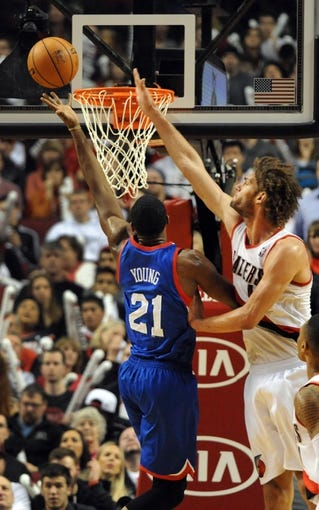Jan. 04, 2014; Portland, OR, USA; Philadelphia 76ers power forward Thaddeus Young (21) drives to the basket on Portland Trail Blazers center Robin Lopez (42) during the fourth quarter of the game at the Moda Center. The Sixers won the game 101-99. Mandatory Credit: Steve Dykes-USA TODAY Sports