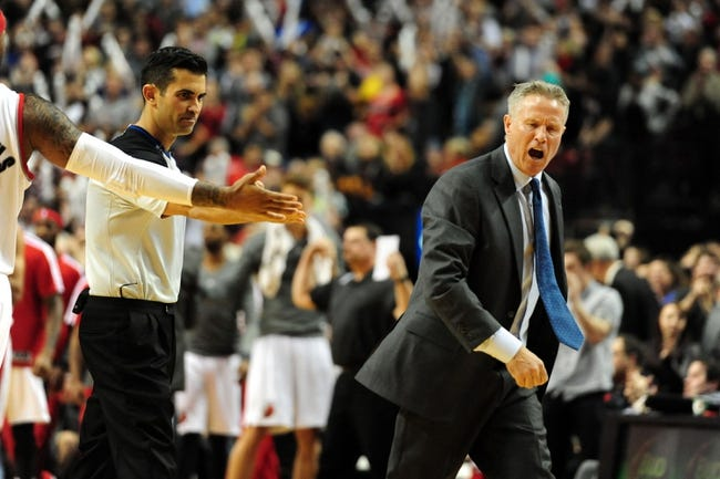 Jan. 04, 2014; Portland, OR, USA; Philadelphia 76ers head coach Brett Brown reacts to a call from referee Eric Dalen during the fourth quarter of the game against the Portland Trail Blazers at the Moda Center. The Sixers won the game 101-99. Mandatory Credit: Steve Dykes-USA TODAY Sports