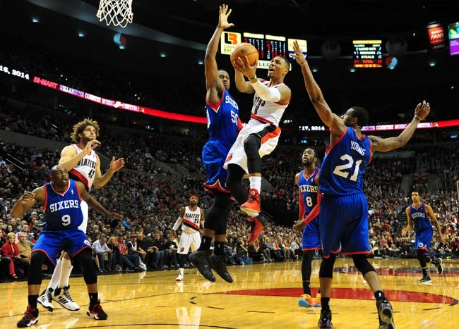 Jan. 04, 2014; Portland, OR, USA; Portland Trail Blazers point guard Damian Lillard (0) drives to the basket on Philadelphia 76ers power forward Lavoy Allen (50) during the fourth quarter of the game at the Moda Center. The Sixers won the game 101-99. Mandatory Credit: Steve Dykes-USA TODAY Sports