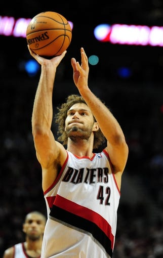 Jan. 04, 2014; Portland, OR, USA; Portland Trail Blazers center Robin Lopez (42) shoots a free throw during the fourth quarter of the game against the Philadelphia 76ers at the Moda Center. The Sixers won the game 101-99. Mandatory Credit: Steve Dykes-USA TODAY Sports