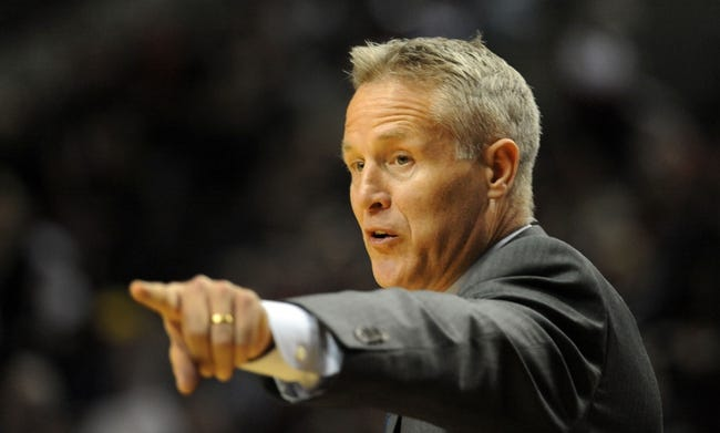Jan. 04, 2014; Portland, OR, USA; Philadelphia 76ers head coach Brett Brown directs his team during the third quarter of the game against the Portland Trail Blazers at the Moda Center. The Sixers won the game 101-99. Mandatory Credit: Steve Dykes-USA TODAY Sports