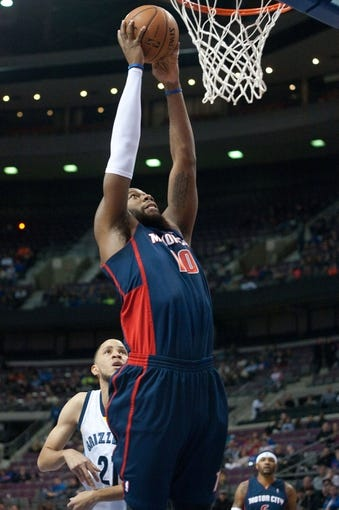 Jan 5, 2014; Auburn Hills, MI, USA; Detroit Pistons power forward Greg Monroe (10) dunks the ball during the first quarter against the Memphis Grizzlies at The Palace of Auburn Hills. Mandatory Credit: Tim Fuller-USA TODAY Sports