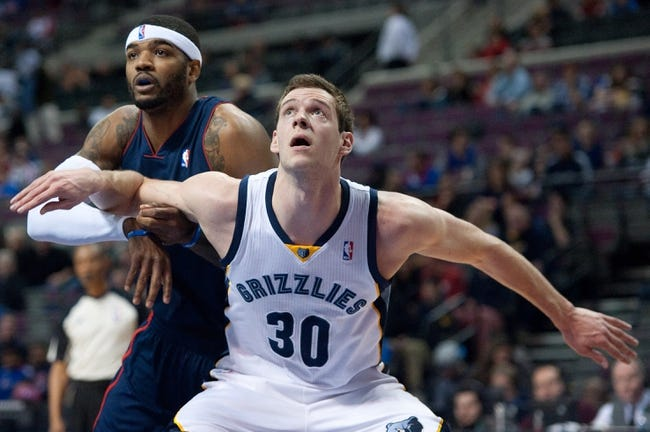 Jan 5, 2014; Auburn Hills, MI, USA; Memphis Grizzlies power forward Jon Leuer (30) defends Detroit Pistons small forward Josh Smith (6) during the second quarter at The Palace of Auburn Hills. Mandatory Credit: Tim Fuller-USA TODAY Sports
