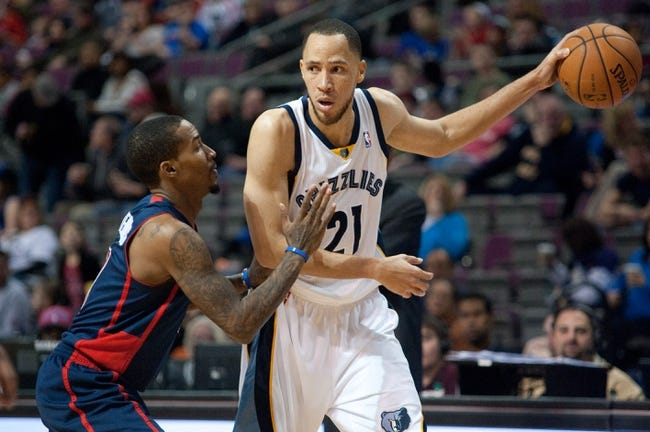 Jan 5, 2014; Auburn Hills, MI, USA; Detroit Pistons point guard Brandon Jennings (7) defends Memphis Grizzlies small forward Tayshaun Prince (21) during the third quarter at The Palace of Auburn Hills. The Grizzlies won 112-84. Mandatory Credit: Tim Fuller-USA TODAY Sports