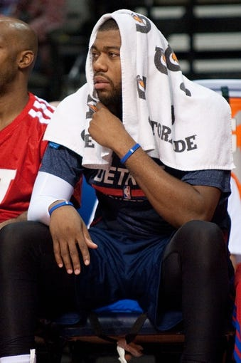 Jan 5, 2014; Auburn Hills, MI, USA; Detroit Pistons power forward Greg Monroe watches from the bench during the fourth quarter against the Memphis Grizzlies at The Palace of Auburn Hills. The Grizzlies won 112-84. Mandatory Credit: Tim Fuller-USA TODAY Sports