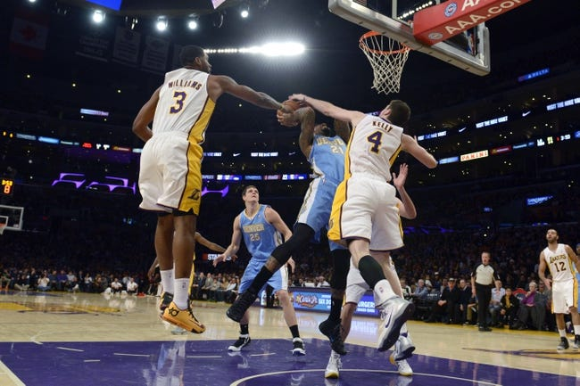 Jan 5, 2014; Los Angeles, CA, USA; Denver Nuggets forward Wilson Chandler (21) attempts a shot defended by Los Angeles Lakers forward Ryan Kelly (4) during the first period at Staples Center. Mandatory Credit: Kelvin Kuo-USA TODAY Sports