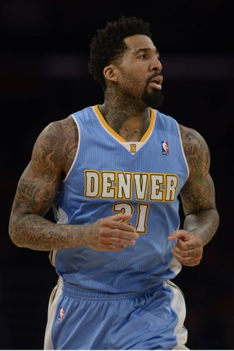 Jan 5, 2014; Los Angeles, CA, USA; Denver Nuggets forward Wilson Chandler (21) runs down the court during the game against the Los Angeles Lakers during the third period at Staples Center. The Denver Nuggets defeated the Los Angeles Lakers 137-115. Mandatory Credit: Kelvin Kuo-USA TODAY Sports