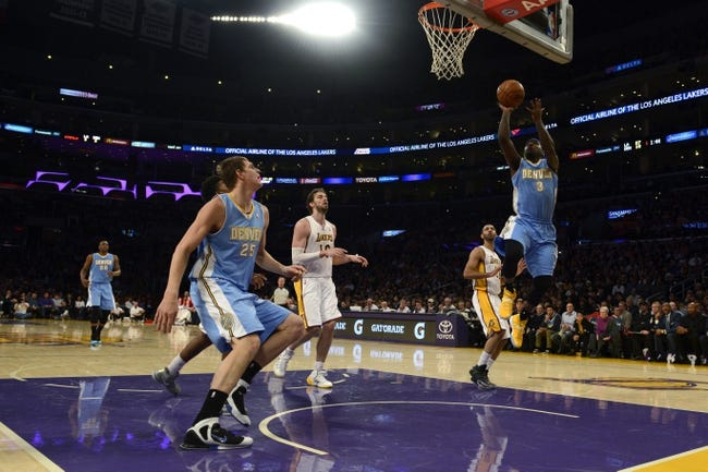 Jan 5, 2014; Los Angeles, CA, USA; Denver Nuggets guard Ty Lawson (3) goes up for a shot against the Los Angeles Lakers during the first period at Staples Center. Mandatory Credit: Kelvin Kuo-USA TODAY Sports