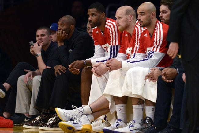 Jan 5, 2014; Los Angeles, CA, USA; Los Angeles Lakers guard Kobe Bryant (24) sits on the bench during the game against the Denver Nuggets during the third period at Staples Center. The Denver Nuggets defeated the Los Angeles Lakers 137-115. Mandatory Credit: Kelvin Kuo-USA TODAY Sports