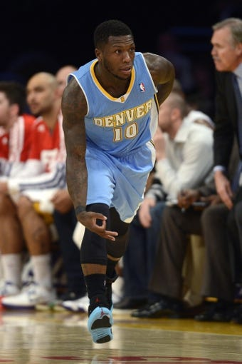 Jan 5, 2014; Los Angeles, CA, USA; Denver Nuggets guard Nate Robinson (10) reacts after making a three point shot against the Los Angeles Lakers during the fourth period at Staples Center. The Denver Nuggets defeated the Los Angeles Lakers 137-115. Mandatory Credit: Kelvin Kuo-USA TODAY Sports