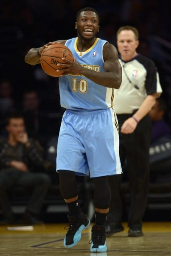 Jan 5, 2014; Los Angeles, CA, USA; Denver Nuggets guard Nate Robinson (10) reacts during the game against the Los Angeles Lakers during the fourth period at Staples Center. The Denver Nuggets defeated the Los Angeles Lakers 137-115. Mandatory Credit: Kelvin Kuo-USA TODAY Sports