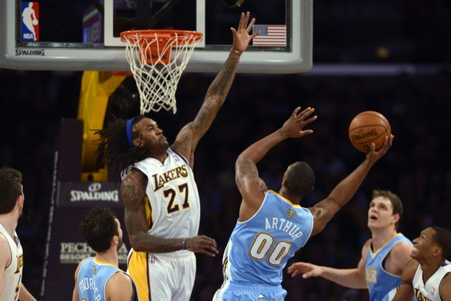 Jan 5, 2014; Los Angeles, CA, USA; Denver Nuggets Darrell Arthur (00) goes up for a shot defended by Los Angeles Lakers center Jordan Hill (27) during the third period at Staples Center. The Denver Nuggets defeated the Los Angeles Lakers 137-115. Mandatory Credit: Kelvin Kuo-USA TODAY Sports