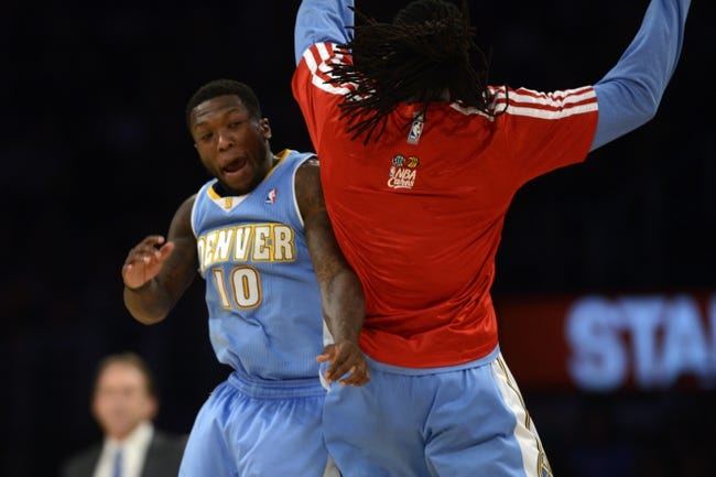 Jan 5, 2014; Los Angeles, CA, USA; Denver Nuggets guard Nate Robinson (10) and Denver Nuggets forward Kenneth Faried (35) celebrate after a time out is called against the Los Angeles Lakers during the fourth period at Staples Center. The Denver Nuggets defeated the Los Angeles Lakers 137-115. Mandatory Credit: Kelvin Kuo-USA TODAY Sports
