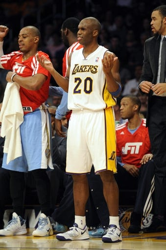 Jan 5, 2014; Los Angeles, CA, USA; Los Angeles Lakers guard Jodie Meeks (20) reacts during the game against the Denver Nuggets during the second period at Staples Center. Mandatory Credit: Kelvin Kuo-USA TODAY Sports