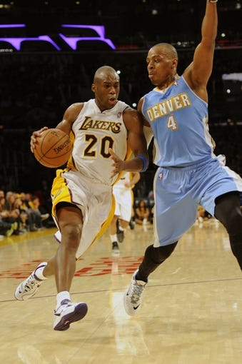 Jan 5, 2014; Los Angeles, CA, USA; Los Angeles Lakers guard Jodie Meeks (20) drives the ball defended by Denver Nuggets guard Randy Foye (4) during the third period at Staples Center. The Denver Nuggets defeated the Los Angeles Lakers 137-115. Mandatory Credit: Kelvin Kuo-USA TODAY Sports