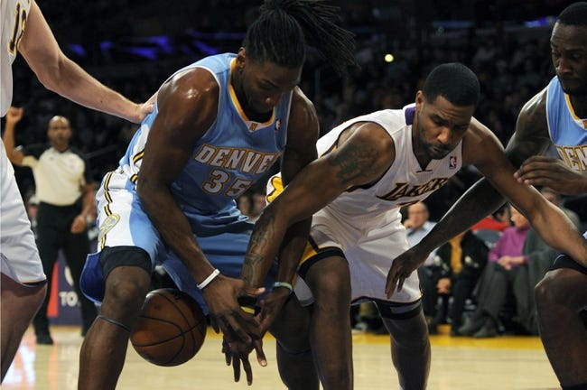 Jan 5, 2014; Los Angeles, CA, USA; Denver Nuggets forward Kenneth Faried (35) and Los Angeles Lakers forward Shawne Williams (3) battle for the loose ball during the first period at Staples Center. Mandatory Credit: Kelvin Kuo-USA TODAY Sports