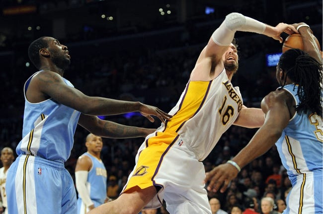 Jan 5, 2014; Los Angeles, CA, USA; Los Angeles Lakers center Pau Gasol (16) is fouled by Denver Nuggets forward Kenneth Faried (35) while going up for a shot during the third period at Staples Center. The Denver Nuggets defeated the Los Angeles Lakers 137-115. Mandatory Credit: Kelvin Kuo-USA TODAY Sports