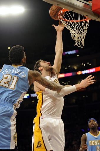 Jan 5, 2014; Los Angeles, CA, USA; Los Angeles Lakers center Pau Gasol (16) attempts a shot defended by Denver Nuggets forward Wilson Chandler (21) during the third period at Staples Center. The Denver Nuggets defeated the Los Angeles Lakers 137-115. Mandatory Credit: Kelvin Kuo-USA TODAY Sports